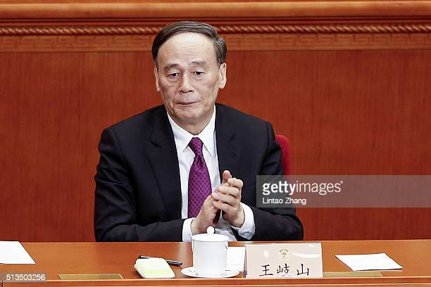 Secretary of the Central Commission for Discipline Inspection Wang Qishan attends opening session of the Chinese People's Political Consultative...