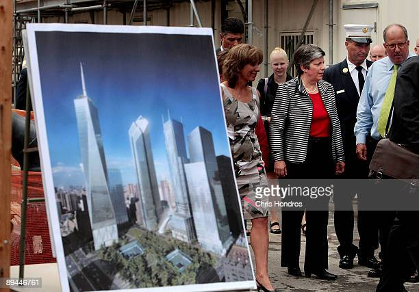 Secretary of the Department of Homeland Security Janet Napolitano walks past a drawing of the planned future World Trade Center complex while on a...