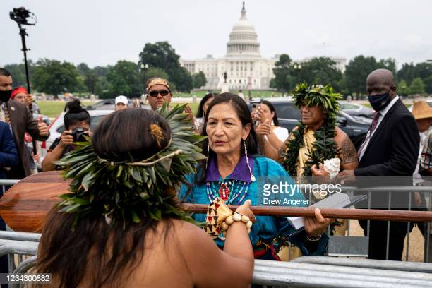 Secretary of the Interior Deb Haaland greets guests after speaking during a welcome ceremony for a totem pole carved by the House of Tears Carvers of...