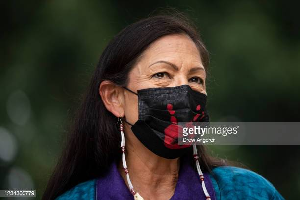 Secretary of the Interior Deb Haaland prepares to take the stage during a welcome ceremony for a totem pole carved by the House of Tears Carvers of...