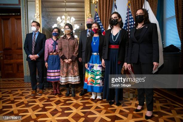 Secretary of the Interior Deb Haaland , U.S. Vice President Kamala Harris , and Haaland's family members pose for a photo following a ceremonial...