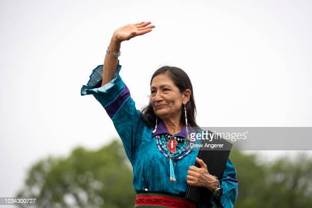 Secretary of the Interior Deb Haaland waves to the crowd after speaking during a welcome ceremony for a totem pole carved by the House of Tears...