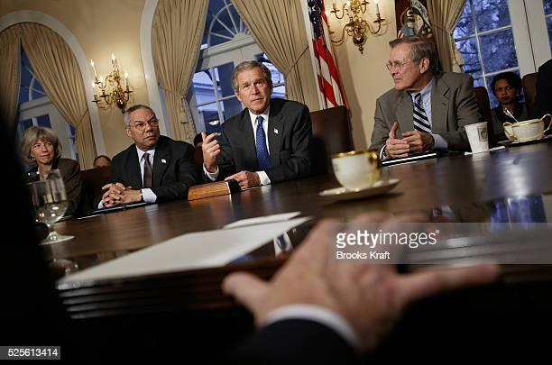 Secretary of the Interior Gail Norton Secretary of State Colin Powell US President George W Bush and Defense Secretary Donald Rumsfield hold a...