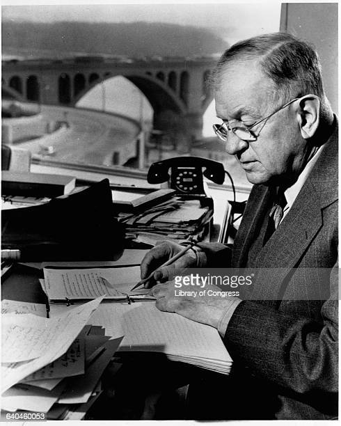 Secretary of the Interior Harold Ickes working at his desk.