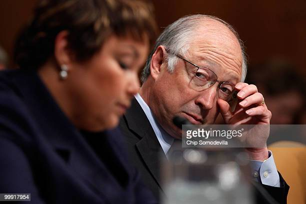 S Secretary of the Interior Ken Salazar listens to Environmental Protection Agency Administrator Lisa Jackson testify about the government response...