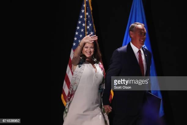 Secretary of the Interior Ryan Zinke alongside his wife Lolita Zinke speaks during the NRAILA's Leadership Forum at the 146th NRA Annual Meetings...