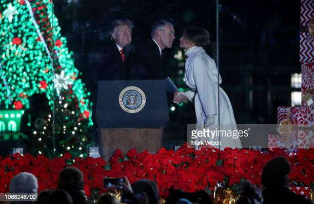 Secretary of the Interior Ryan Zinke greets First Lady Melania Trump after introducing President Donald Trump during the National Christmas Tree...