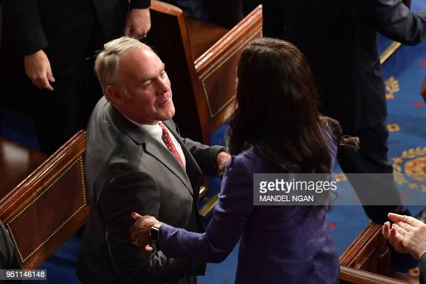 US Secretary of the Interior Ryan Zinke is seen after France's President Emmanuel Macron addressed a joint meeting of Congress inside the House...