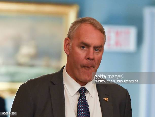 US Secretary of the Interior Ryan Zinke looks on before a luncheon with French President Emmanuel Macron and US Vice President Mike Pence at the US...