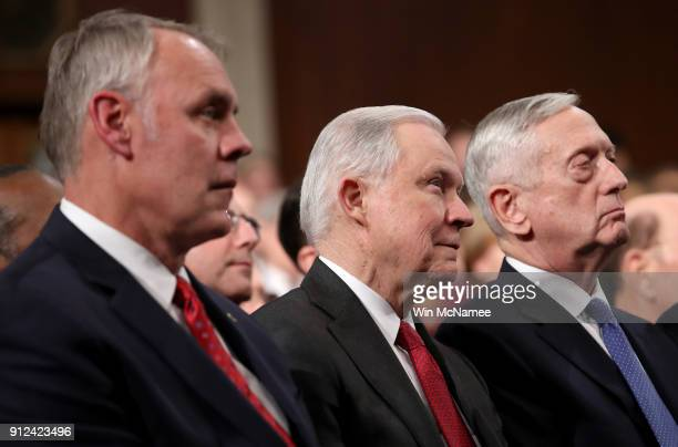 Secretary of the Interior Ryan Zinke US Attoney General Jeff Sessions and US Secretary of Defense Jim Mattis watch during the State of the Union...