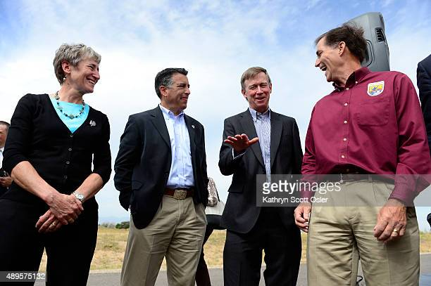 S Secretary of the Interior Sally Jewell left gathers after the meeting with Nevada Gov Brian Sandoval second from left Colorado Gov John...