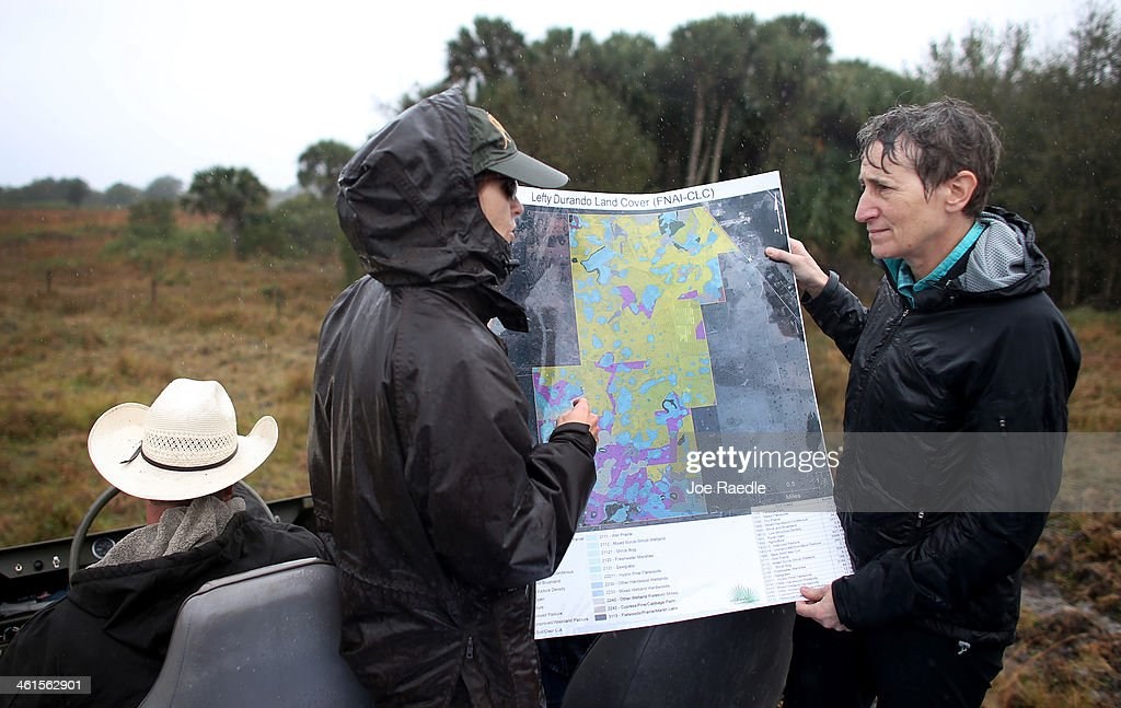 Secretary of the Interior Sally Jewell (R) looks at a map with Erin Myers , Private Lands Biologist with US Fish and Wildlife Service, during a visit to meet with ranchers and private landowners on January 9, 2014 in Okeechobee, Florida. Jewell made a visit to the area to discuss the next steps for the Everglades Headwaters National Wildlife Refuge and Conservation Area.