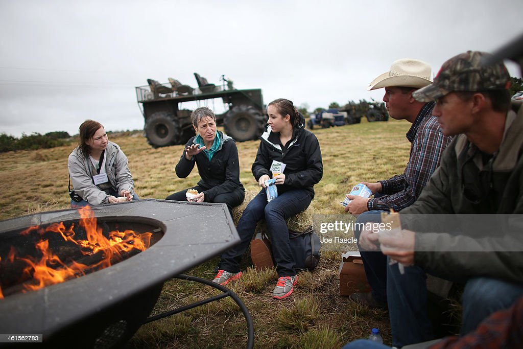 Secretary of the Interior Sally Jewell (2nd L) sits with Christine McGowan (L-R), Emily Paciolla, Jay Belflower and Jake Carlton during a visit to meet with ranchers and private landowners on January 9, 2014 in Okeechobee, Florida. Jewell made a visit to the area to discuss the next steps for the Everglades Headwaters National Wildlife Refuge and Conservation Area.