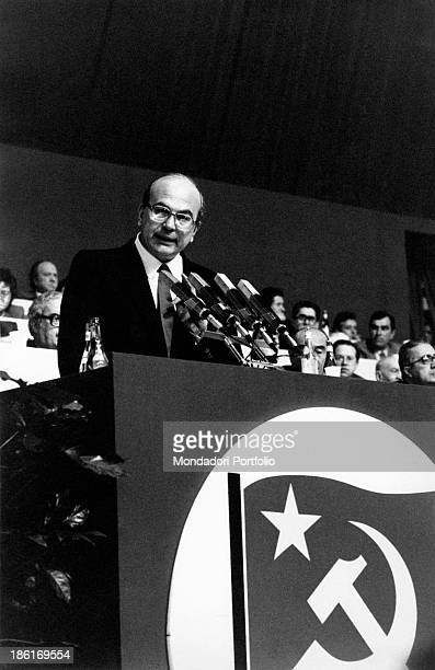 Secretary of the Italian Socialist Party Bettino Craxi giving a speech at a congress of Italian Communist Party In front of the stage the party's...
