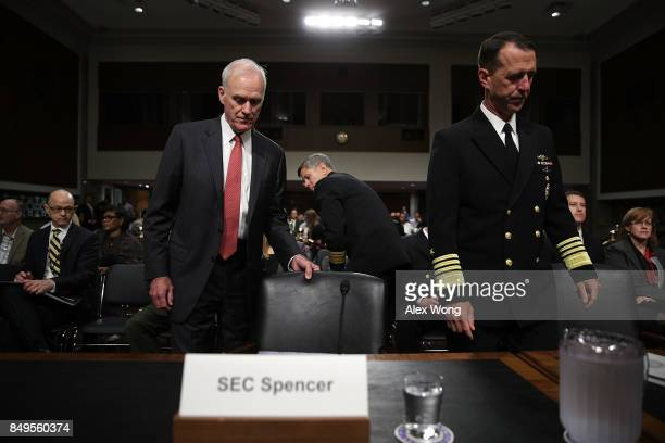 S Secretary of the Navy Richard Spencer and Chief of Naval Operations Adm John Richardson take their seats prior to a hearing before Senate Armed...