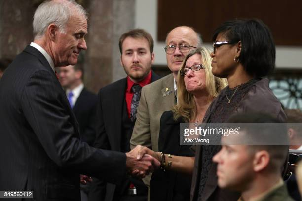 S Secretary of the Navy Richard Spencer greets family members mother Rachel Eckels of Information Systems Technician 2nd ClassÊTimothy Eckels parents...
