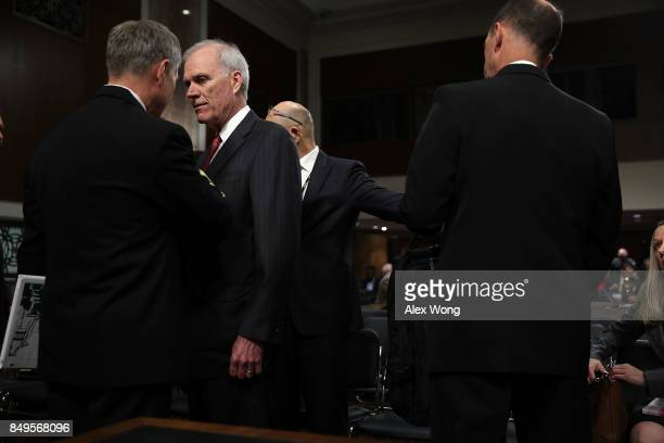 S Secretary of the Navy Richard Spencer listens to an aide prior to a hearing before Senate Armed Services Committee September 19 2017 on Capitol...