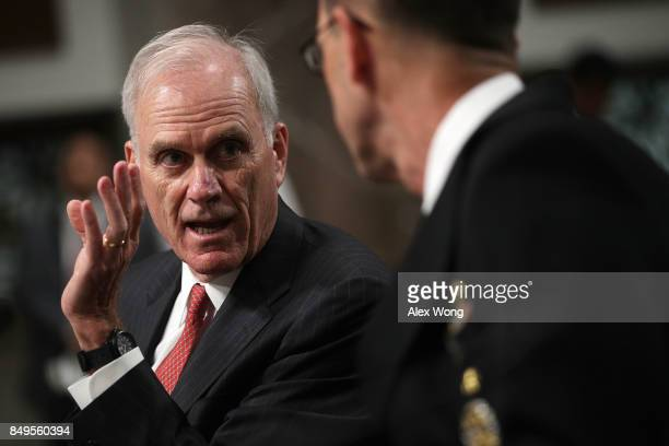 S Secretary of the Navy Richard Spencer talks to Chief of Naval Operations Adm John Richardson prior to a hearing before Senate Armed Services...