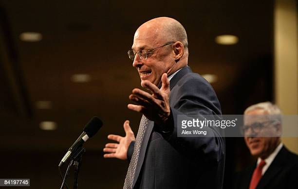S Secretary of the Treasury Henry Paulson answers questions as David Rubenstein President of The Economic Club of Washington DC looks on during...