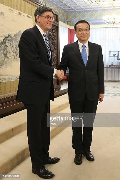 Secretary of the Treasury Jack Lew shakes hands with Chinese Premier Li Keqiang ahead of a meeting in Zhongnanhai Leadership Compound on February 29...
