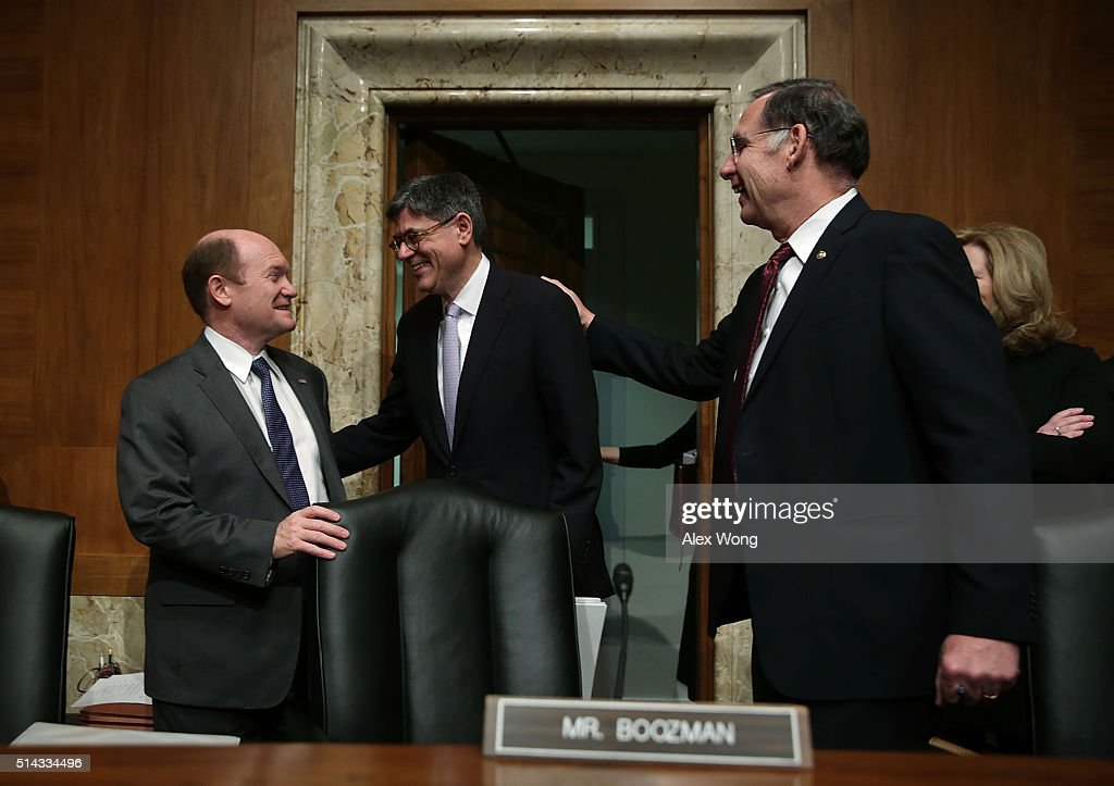 U.S. Secretary of the Treasury Jacob Lew (C) is greeted by Sen. Christopher Coons (D-DE) (L) and Sen. John Boozman (R-AR) (R) during a hearing before the Financial Services and General Government Subcommittee of the Senate Appropriations Committee March 8, 2016 on Capitol Hill in Washington, DC. The subcommittee held a hearing to examine the FY2017 budget for the Treasury Department.