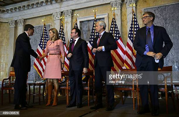 US Secretary of the Treasury Jacob Lew shakes hands with Queen Maxima of the Netherlands as Mexican Secretary of Finance and Public Credit Luis...