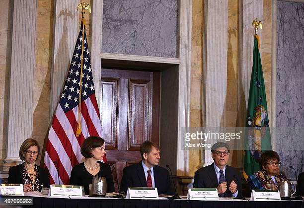 S Secretary of the Treasury Jacob Lew speaks as Assistant Director of Office of Financial Education of Consumer Financial Protection Bureau Janneke...