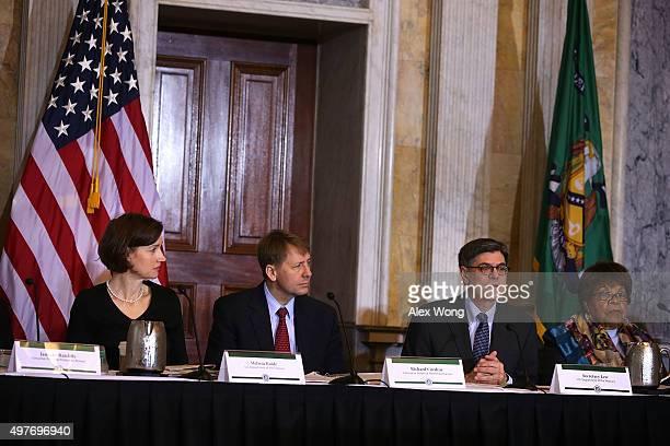 S Secretary of the Treasury Jacob Lew speaks as Deputy Assistant Treasury Secretary for Consumer Policy Melissa Koide Consumer Financial Protection...