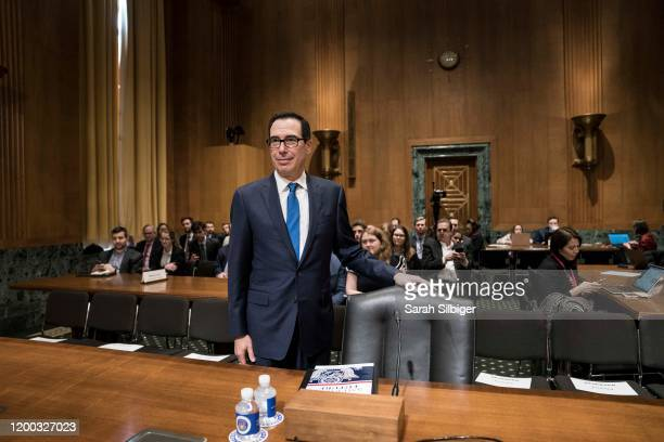 Secretary of the Treasury Steven Mnuchin arrives to testify before the Senate Finance Committee during a hearing on The President's FY2021 Budget in...