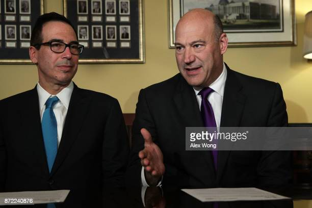 S Secretary of the Treasury Steven Mnuchin listens as Director of the National Economic Council Gary Cohn speaks during a meeting with members of the...