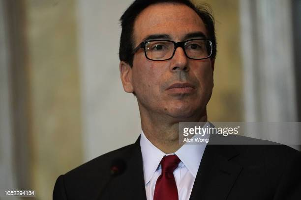 S Secretary of the Treasury Steven Mnuchin listens during a Financial Stability Oversight Council meeting October 16 2018 at the Treasury Department...