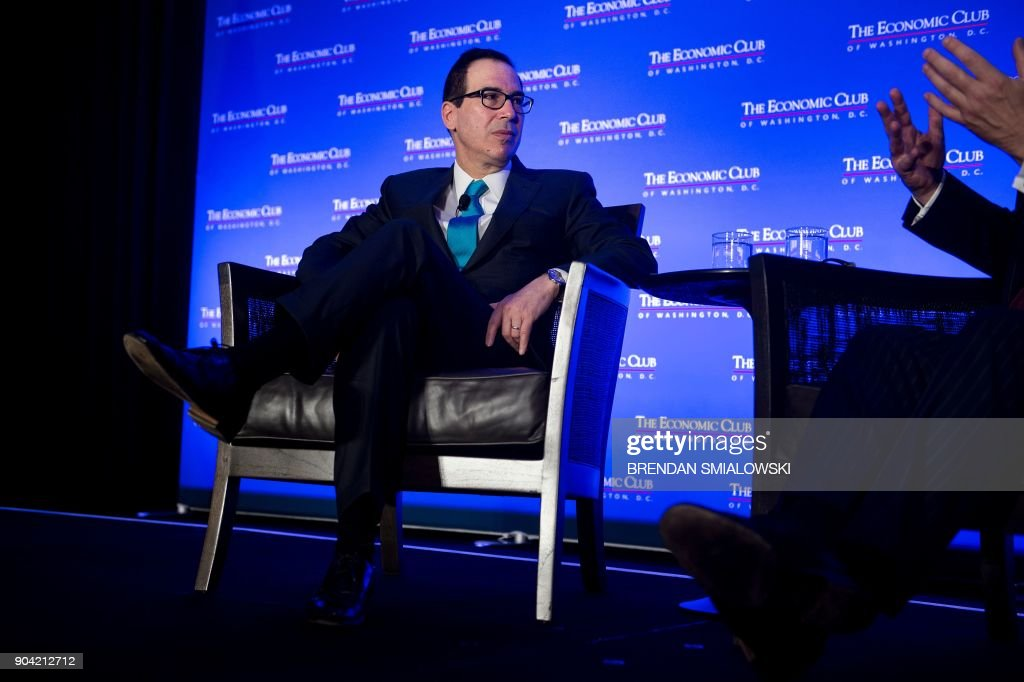 US Secretary of the Treasury Steven Mnuchin listens during a meeting at the Economics Club of Washington on January 12, 2018 in Washington, DC. / AFP PHOTO / Brendan Smialowski
