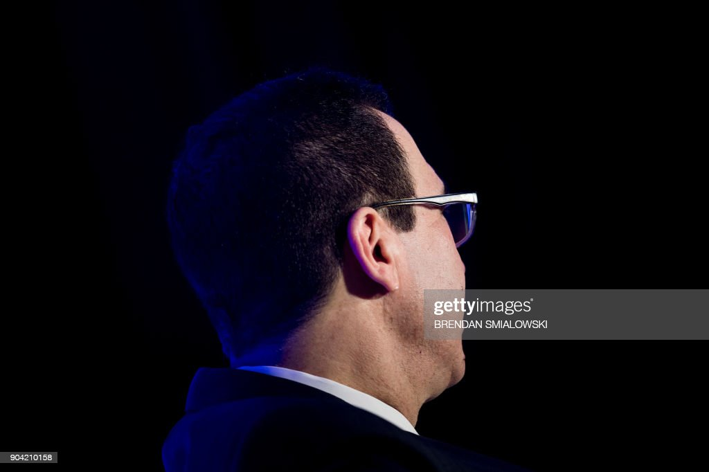 US Secretary of the Treasury Steven Mnuchin listens during a meeting on tax reform at the Economics Club of Washington on January 12, 2018 in Washington, DC. / AFP PHOTO / Brendan Smialowski