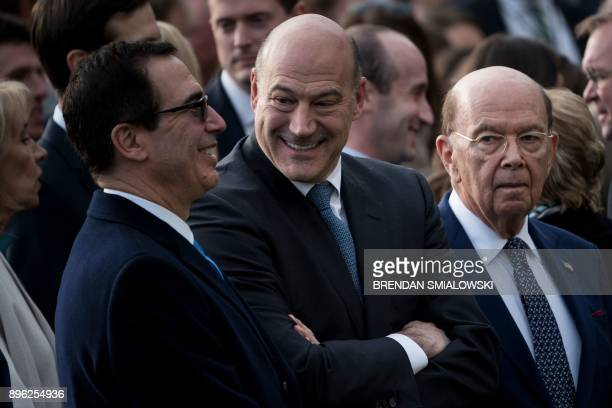 US Secretary of the Treasury Steven Mnuchin National Economic Council Director Gary Cohn and US Secretary of Commerce Wilbur Ross wait for US...