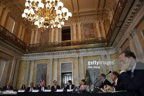Secretary of the Treasury Steven Mnuchin speaks as Chairman of Commodity Futures Trading Commission J. Christopher Giancarlo, Director of Federal...