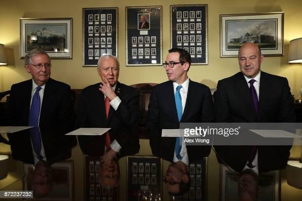S Secretary of the Treasury Steven Mnuchin speaks as Senate Majority Leader Sen Mitch McConnell Senate Finance Committee Chairman Sen Orrin Hatch and...