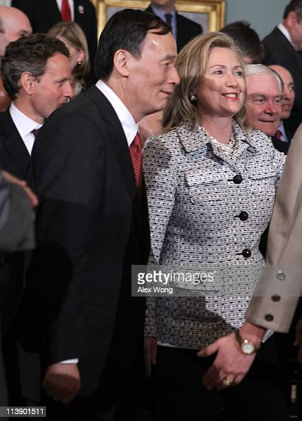S Secretary of the Treasury Timothy Geithner Chinese Vice Premier Wang Qishan US Secretary Hillary Clinton and Secretary of Defense Robert Gates move...