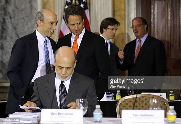S Secretary of the Treasury Timothy Geithner listens to chairman of the US Commodity Futures Trading Commission Gary Gensler prior to the open...