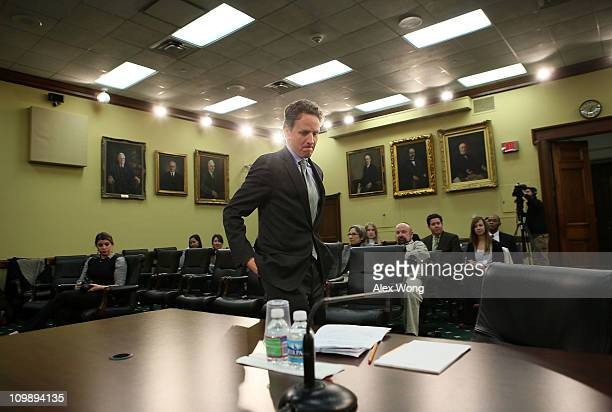 S Secretary of the Treasury Timothy Geithner returns to his seat during a hearing before the State Foreign Operations and Related Programs...