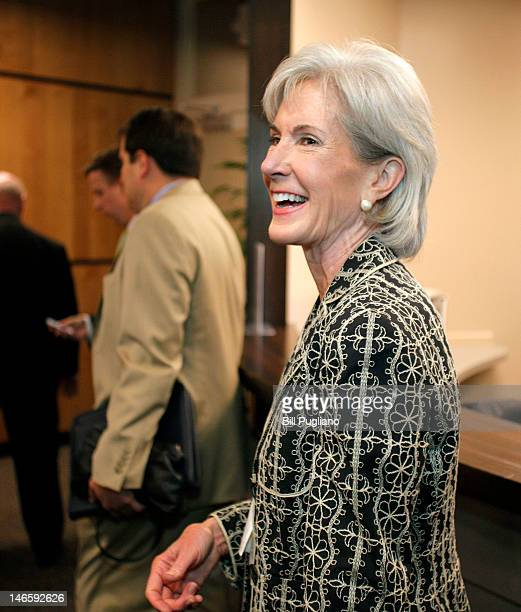 Secretary of the US Department of Health and Human Services Kathleen Sebelius makes her way to a media scrum after speaking about President Barack...