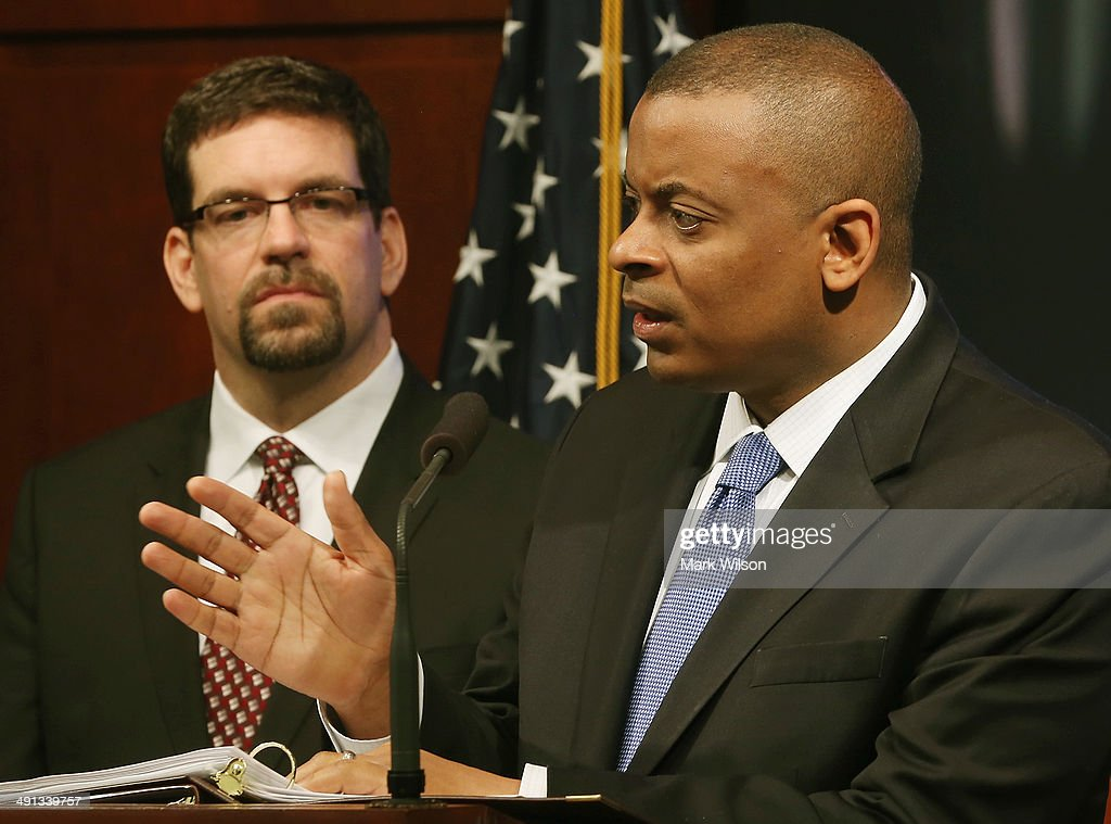 Secretary of Transportation Anthony Foxx (R) and Highway Traffic Safety Administrations Acting Administrator David Friedman speak to the media after announcing that General Motors has agreed to pay a 35 million dollar civil penalty, at the Department of Transportation, May 16, 2014 in Washington DC. Secretary Foxx said that GM violated federal safety laws in the Chevrolet Cobalt investigation.