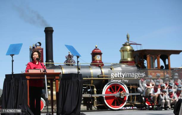 S Secretary of Transportation Elaine Chao gives a speech with the 119 steam engine as the background at the 150th anniversary of the driving of the...