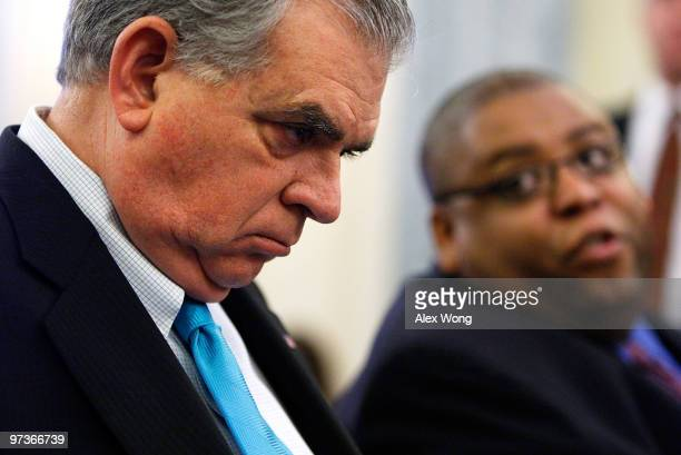 S Secretary of Transportation Ray LaHood listens to National Highway Traffic Safety Administration Administrator David Strickland as they wait for...