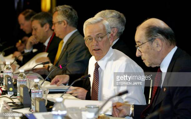 US Secretary of Treasury Paul O'Neill seated next to Federal Reserve Chairman Alan Greenspan starts the G7 Finance Ministers and Central Bank...