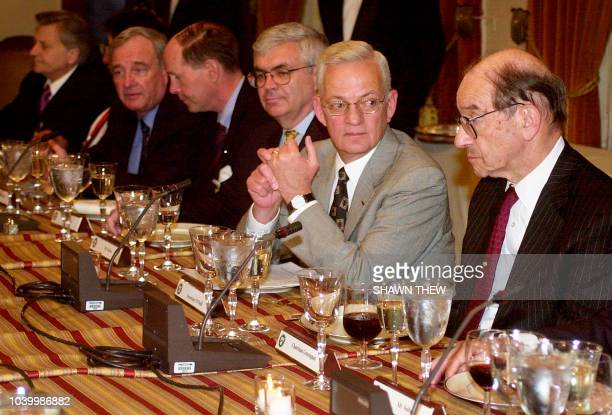 US Secretary of Treasury Paul O'Neill talks with Federal Reserve Chairman Alan Greenspan and US Under Secretary for International Affairs John Taylor...