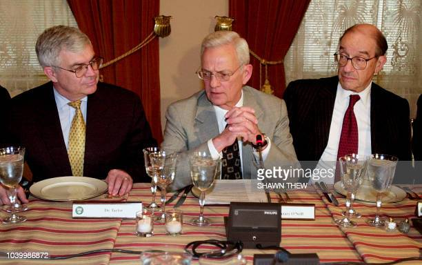 US Secretary of Treasury Paul O'Neill talks with US Under Secretary for International Affairs John Taylor and Federal Reserve Chairman Alan Greenspan...