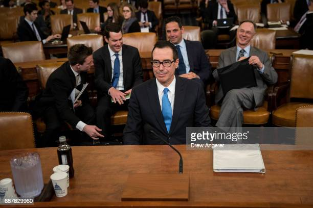 S Secretary of Treasury Steve Mnuchin arrives for a House Ways and Means Committee hearing concerning the Trump administration's fiscal year 2018...
