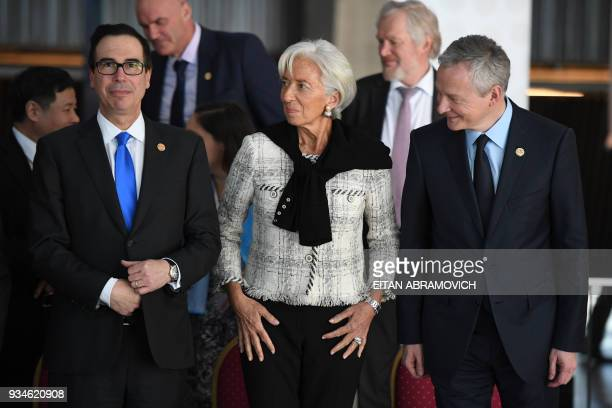 US Secretary of Treasury Steven Mnuchin IMF Managing Director Christine Lagarde and French Economy Minister Bruno Le Maire arrive for the family...