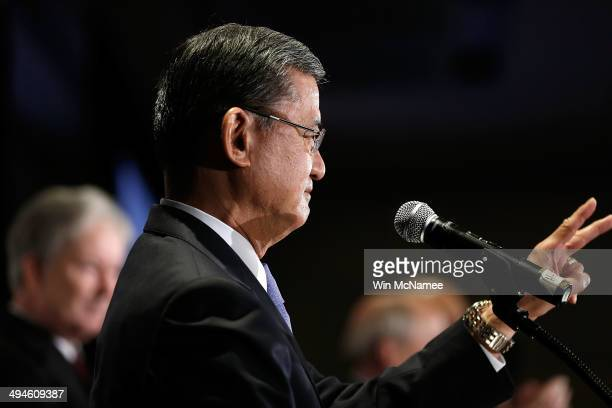 S Secretary of Veterans Affairs Eric Shinseki waves to supporters before addressing the National Coalition for Homeless Veterans May 30 2014 in...