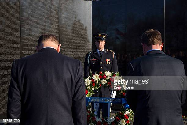 S Secretary of Veterans Affairs Robert McDonald and US Secretary of Defense Ash Carter bow their heads during a wreath laying ceremony to commemorate...